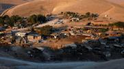 FILE PHOTO: A general view shows the main part of the Palestinian Bedouin encampment of Khan al-Ahmar village that Israel plans to demolish, in the occupied West Bank September 11, 2018. REUTERS/Mohamad Torokman/File Photo - RC1F7FAB5F40
