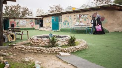 "<p> <span style=""font-size: small;"">Students walk in the school yard in the Palestinian Bedouin community of </span><span style=""font-size: small;"">Khan al Ahmar, Jerusalem Periphery, </span><span style=""font-family: arial, sans-serif; font-size: small;""><font face=""Arial, Verdana, sans-serif"">February 23, 2017. Over the past week, Israeli authorities delivered demolition orders to 40 houses and the elementary school in the village, as well as stop-work orders for various structures. Khan al Ahmar is located in Area C, between the illegal Israeli settlements of Ma'ale Adumim and Kfar Adumim. Since the Jahalin Bedouin communities have a longstanding presence in this area, the community and its school present an obstacle to Israel's planned displacement of the Bedouin communities living in Area C, for the purpose of settlement expansion and further construction of the Separation Wall, leaving the community under constant threat of displacement. Area C consists of more than 60% of the West Bank, and is under full Israeli civil and military control. </font></span></p>"